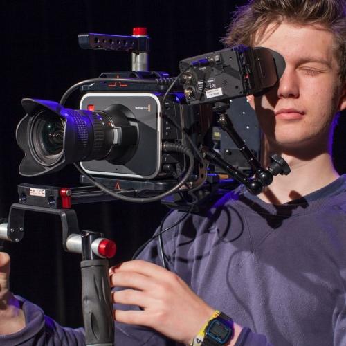 Student behind camera.