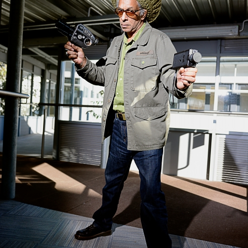 Don Letts holding cine film cameras.