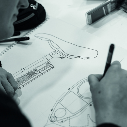 Student drawing design for a bike seat.