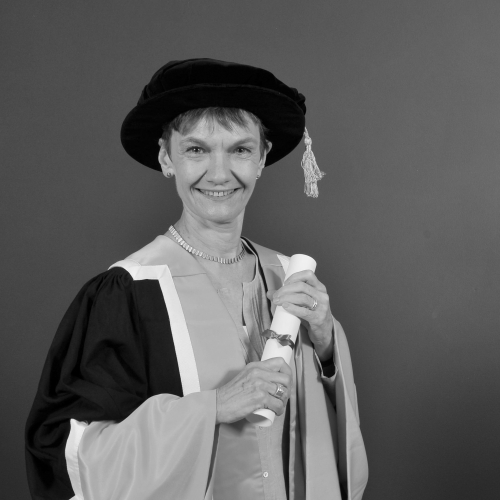 Falmouth honorary fellow Sue Hoyle OBE in academic gown.