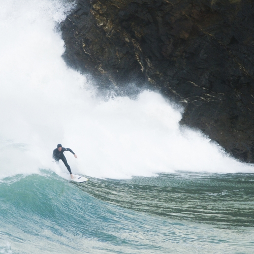 Surfer coming in on large wave.