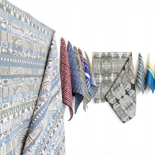 A display of different coloured jacquard woven fabrics.