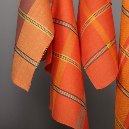 Orange plaid fabrics dangling down.