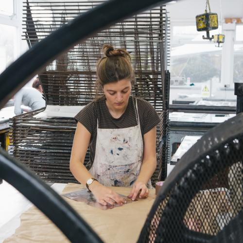 Female student in printmaking studio