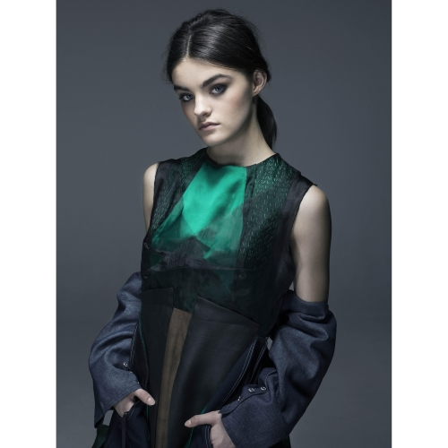 Model in emerald green and blue dress with detached sleeves.